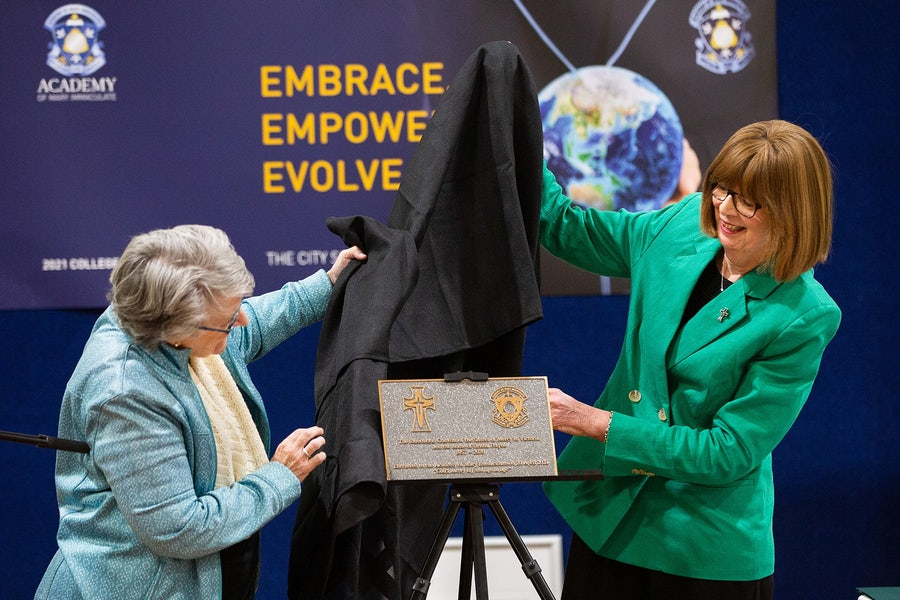 Eveline Crotty rsm (L) and Mary Moloney rsm (R) unveil the plaque