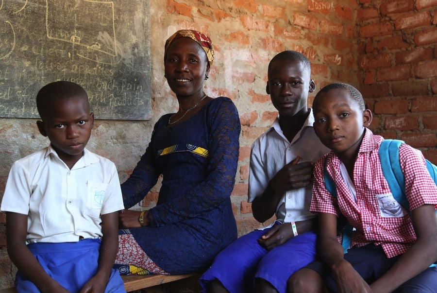 Christine Baptist, Parent, Sunrise Nursery and Primary School, Yambio, South Sudan<br>L-r:12 year old Christine, the mother/parent also Christine, 16 year old Evaresto and 10 year old Kubako