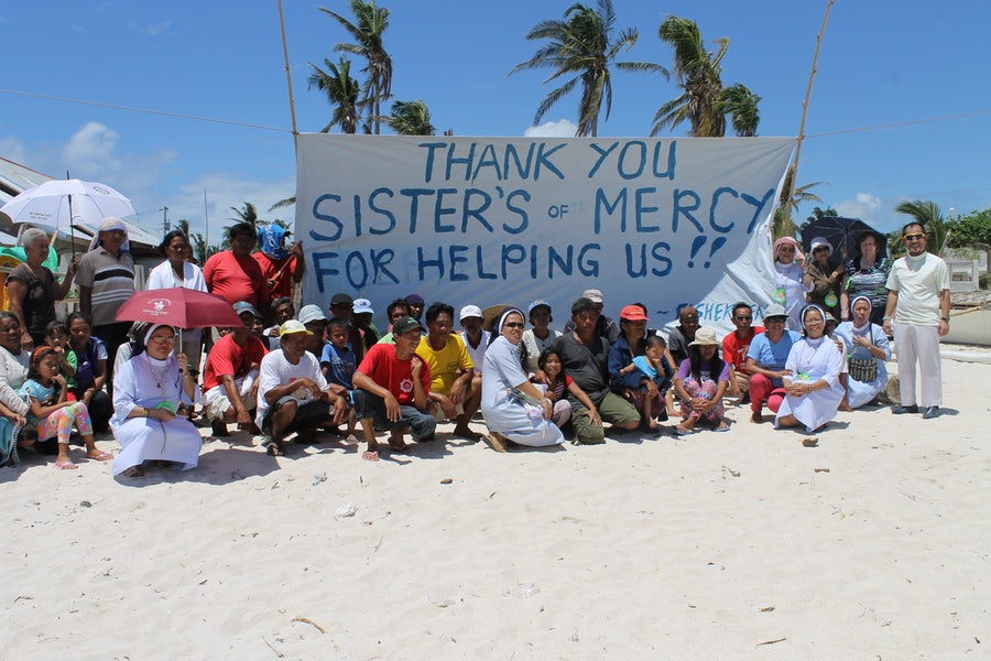 Philippine Mercies and locals thanking MIA for financial support in wake of Typhoon Yolanda, 2013
