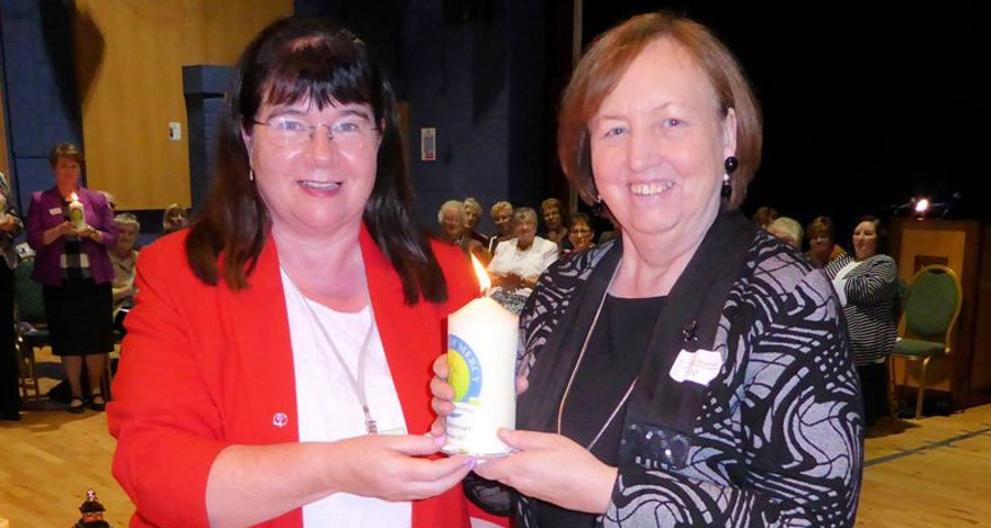 Presentation of candle to Mary Reynolds rsm