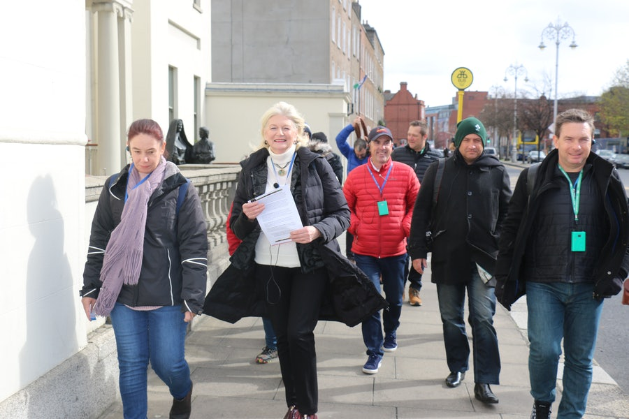 Margaret Roche (2nd from left) leading first group on walk through Catherine's Dublin