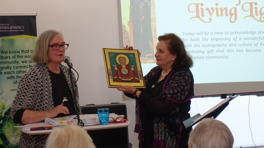 Margaret Broadbent rsm presenting the gift of an icon to Dr Pecherskaya