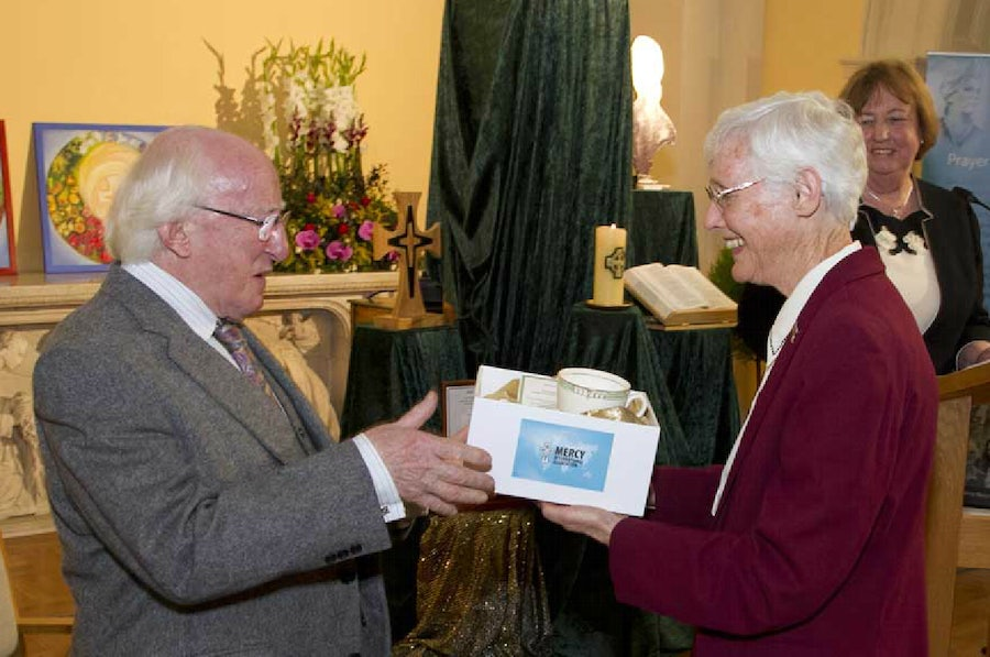 Sr. Gabrielle Ryan presents President Higgins with Catherine McAuley's cup