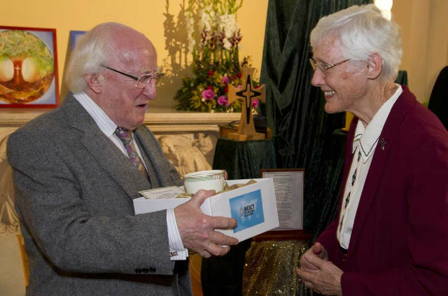 President Higgins receives the cup