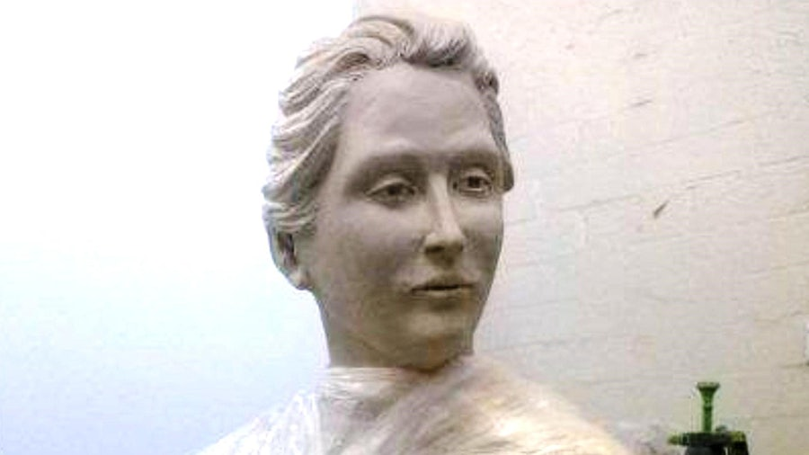 Catherine's face emerging from the clay