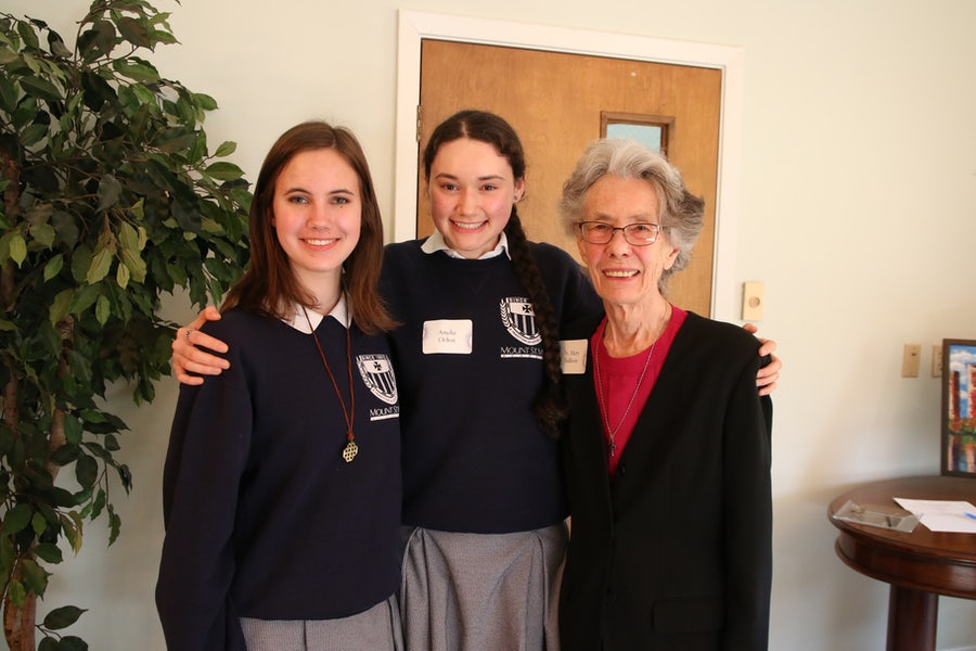 Juniors Anne Lashbrook (left) and Amelia Ochoa with Mary C. sullivan rsm