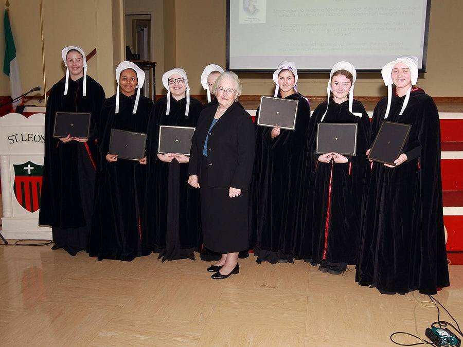 Sr Sheila with the St Leo's students who enacted the pageant representing the early days of the Sisters in Pittsburgh. The student with the lavendar ribbons on her bonnet played Frances Warde. The students are holding the honorary degrees awarded each of the Carlow Seven by Carlow University, Pittsburgh
