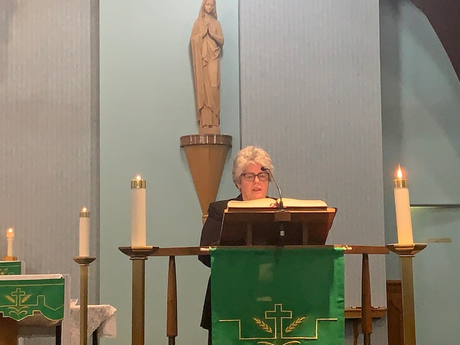 Diane Smyth addressing the congregation at the end of Mass