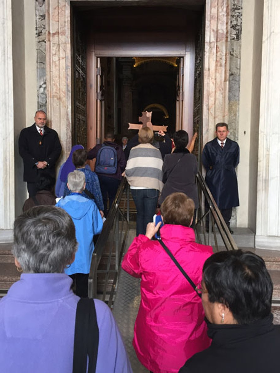 Entering the Basilica by the Holy Door