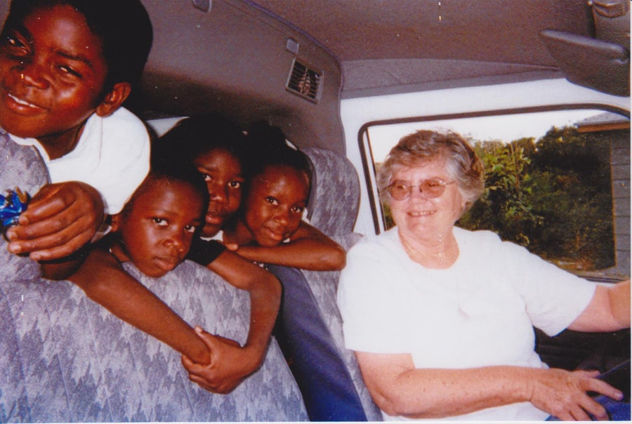 Sister Mary Miller gives a lift to young friends in Cargill Creek, Andros Island, in the late 1990's.