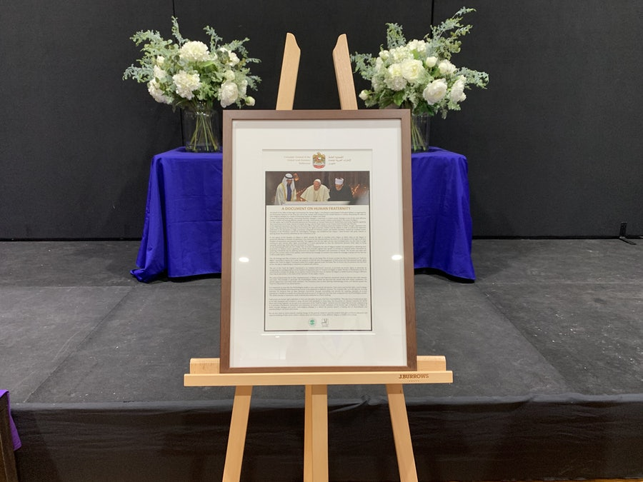 Framed photo of the signing of the Document on Human Fraternity for World Peace and Living Together presented to Mercy College