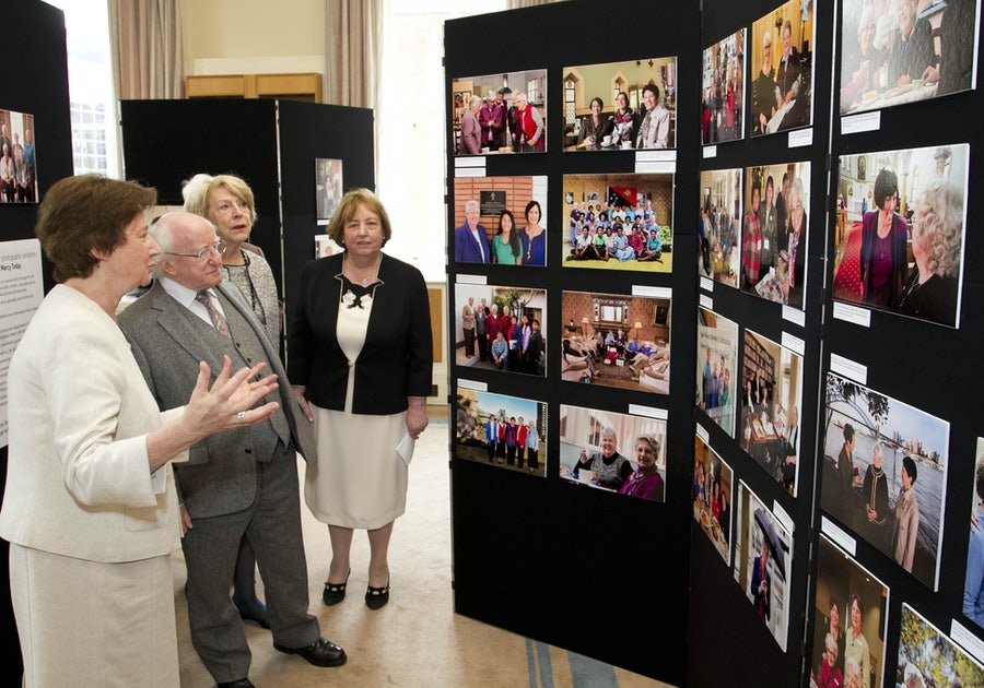 Adele Howard rsm & Mary reynolds rsm with President Higgins and  Sabina at this opening of the 20th Anniversary Photographic Exhibition
