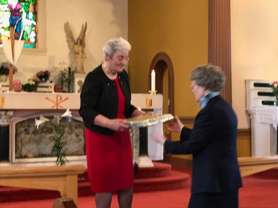 Helen Keating (Associate) presents plaque to Sr Geraldine Mason