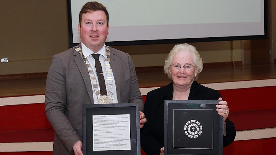 Chairperson of Carlow County Council, Councillor Brian O'Donoghue with Sheila Carney rsm and the presentation