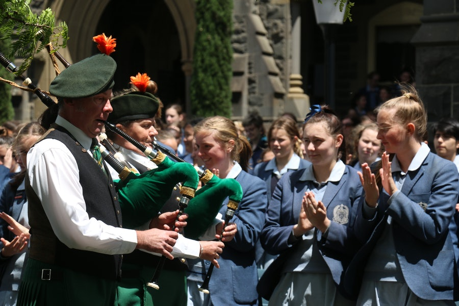 Pipers leading Sisters & Guests through Student Guard of Honour to the Sisters of Mercy Cemetery for the Blessing & Rose Ceremony.
