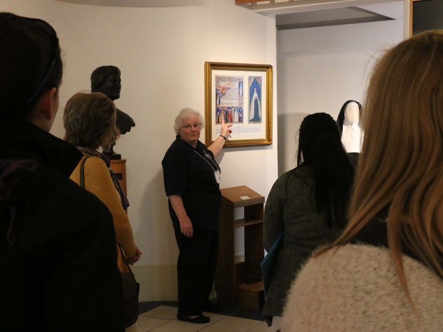 Sheila Carney rsm pointing out the portrait of Catherine McAuley
