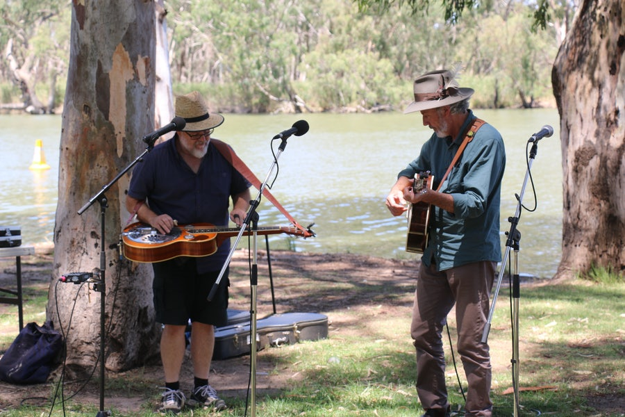 Chris Rogers (left) and Shane Howard (right) perform 'Heart of My Country'.