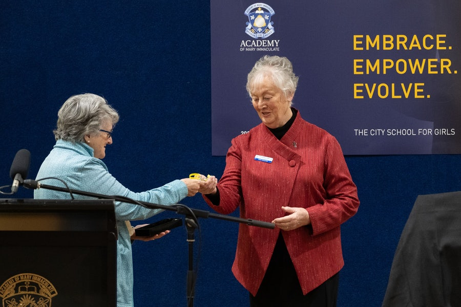 (L) Eveline Crotty rsm, Institute Leader, handing key to Sylvia Williams rsm, Chair, Mercy Education