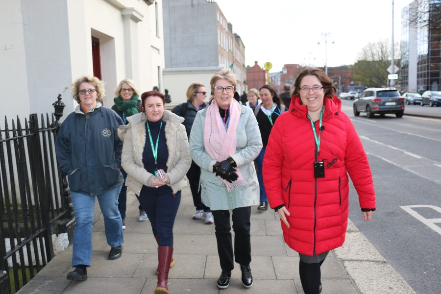 Anna Nicholls rsm (far right) leads the second group on the walking tour