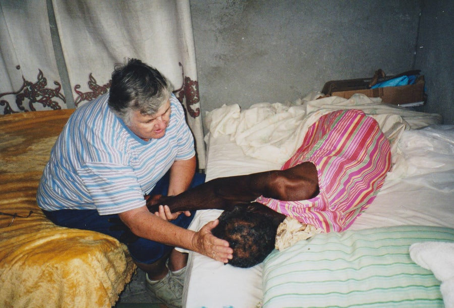 "Sister David Mary Duncan, who served in the Bahamas for 40 years, comforts a woman in Mangrove Cay (pronounced ""key"") in the early 2000's."