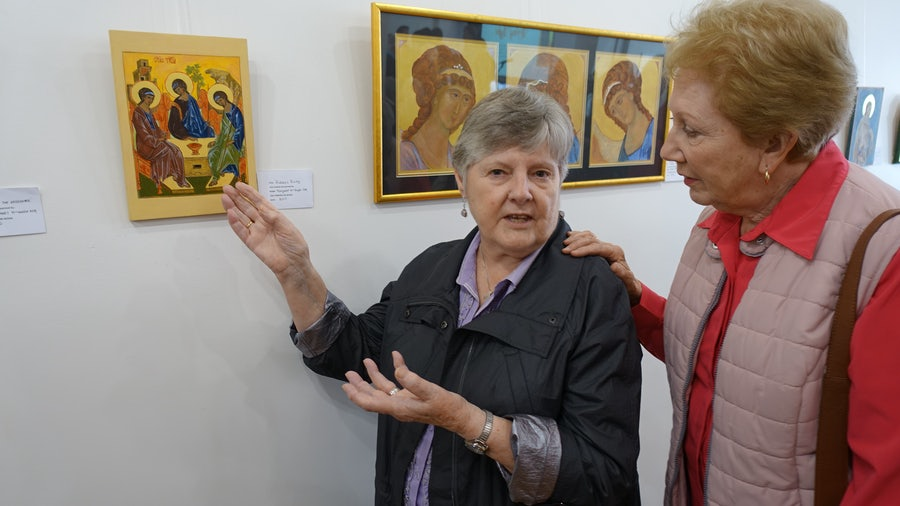 Margaret McHugh rsm points out one of her icons to Monica Spiteri