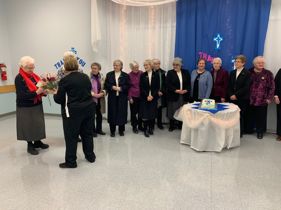 Presentation of a rose to Sr Rosaline, the last Sister to serve on Bell Island